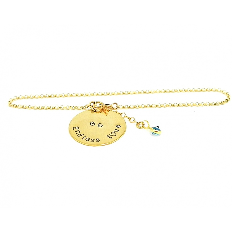 Gold plated bracelet with gold plated silver disks and evil eye