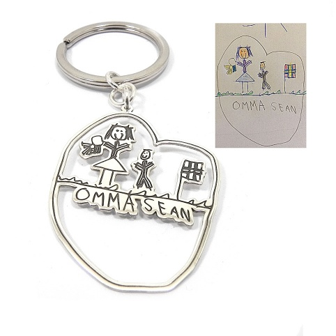 Kids drawing silver keychain, actual child drawing key chain