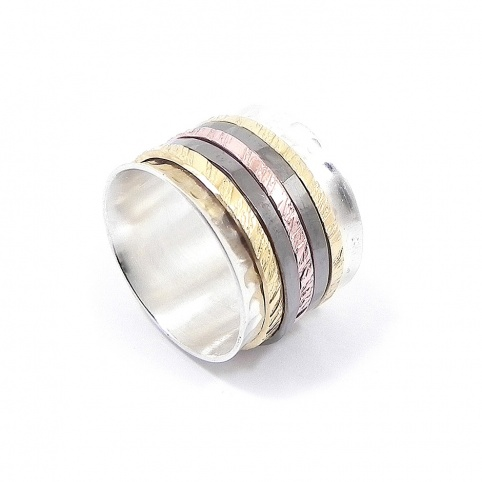 Silver ring with 5 spinners