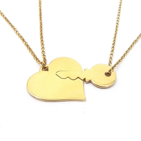 Double heart necklace with key in gold plated aterling silver
