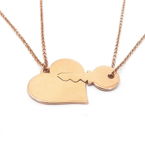 Double heart necklace with key in gold plated sterling silver