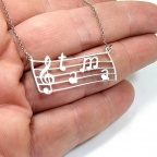 Musical pentagram necklace with monograms as notes