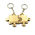 Double wooden puzzle keychain with engraving of your favorite date and monograms